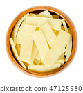Canned bamboo shoots in wooden bowl over white 47125580