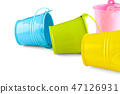 Four small colorful buckets. 47126931