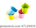 Four small colorful buckets. 47126935
