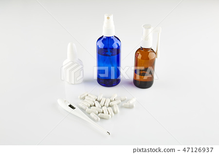 Bottles with medicine, thermometer and pills 47126937