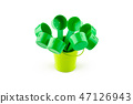 Green plastic spoons in small bucket. 47126943