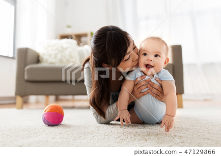 happy young mother kissing little baby at home 47129866