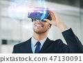 businessman with virtual reality headset at office 47130091