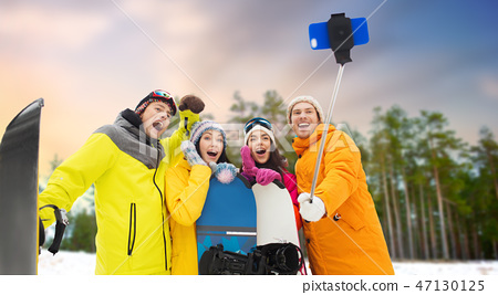 happy friends with snowboards and smartphone 47130125