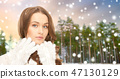 close up of beautiful woman over winter forest 47130129
