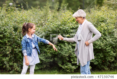 grandma and granddaughter with insect repellent 47130746