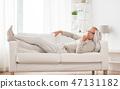senior man lying on sofa and thinking at home 47131182