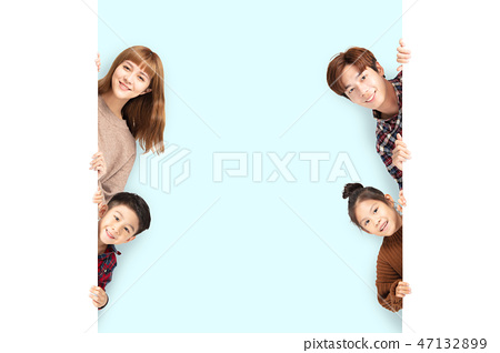 happy Family posing  behind blank white board 47132899