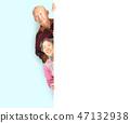 senior couple posing  behind blank white board 47132938