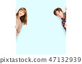 young couple posing  behind blank white board 47132939