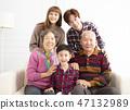 happy three generations asian family on sofa 47132989