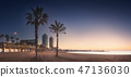 Dramatic sunrset on beach of Barcelona with palm 47136030