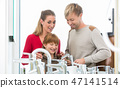 Portrait of a happy family together in the interior of a modern shop 47141514