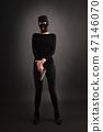 Girl in Black with Gun 47146070