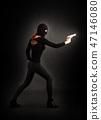 Girl in Black with Gun 47146080