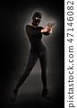 Girl in Black with Gun 47146082