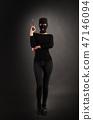 Girl in Black with Gun 47146094