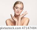 Close-up portrait of young, beautiful and healthy woman with arrows on her face 47147484