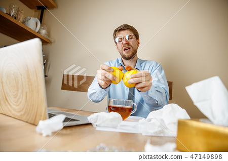 Sick man while working in office, businessman caught cold, seasonal flu. 47149898