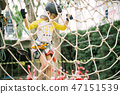 Happy  girl enjoying activity in a adventure park 47151539