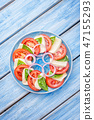 Caprese salad on a blue plate with an ornament on  47155293