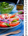 Caprese salad on a blue plate with an ornament on  47155294