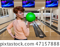 Beautiful young woman with bowling ball in a new bowling alley 47157888