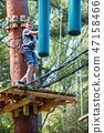 Cute little boy enjoying his time in climbing adventure park 47158466