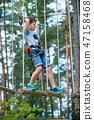 Cute little boy enjoying his time in climbing adventure park 47158468