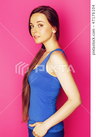 young happy slim girl with skipping rope on pink background smil 47176104