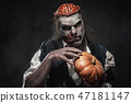 Scary zombie prostheric makeup on male model 47181147