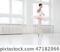 Gracefull ballerina in a dance studio 47182966