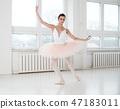 Gracefull ballerina in a dance studio 47183011