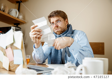 Sick man while working in office, businessman caught cold, seasonal flu. 47185127