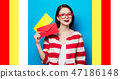smiling woman with two envelopes 47186148