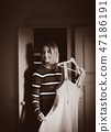 Young girl choose a dress at home near wardrobe 47186191