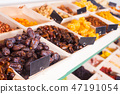 Dried fruits in wooden containers on a rack 47191054