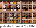 Shelf made of cubic cells filled with jars 47191061