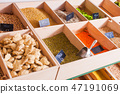 Close view of grocery products on a wooden shelf 47191069