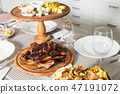 Grilled ribs and backed potato on the served table 47191072