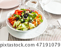Salad with fresh vegetables, olives and pumpkin sprouts 47191079