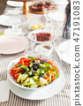 Salad with fresh vegetables, olives and pumpkin sprouts 47191083