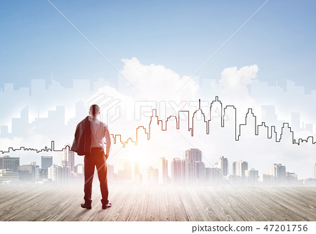 Motivation and inspiration concept with modern cityscape and businessman observing it 47201756