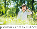 Boy enjoying music 47204729