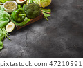 Assorted green toned raw organic vegetables  47210591