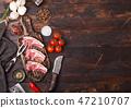 Fresh raw butchers lamb beef cutlets on board  47210707