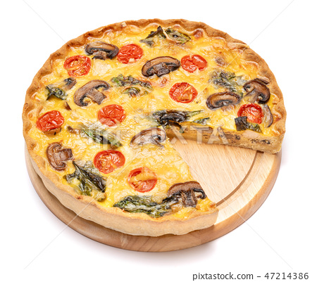 Baked homemade quiche pie on wooden cutting board 47214386