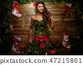 Woman in Christmas tree dress with glass of champagne and sparkler 47215861