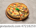 Traditional french Baked homemade quiche pie on wooden cutting board 47216250