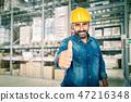 smiling handyman in warehouse 47216348